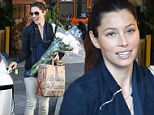 She must LOVE roses! Makeup free Jessica Biel sports an insatiable grin as she picks up flowers