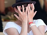 Can't bare to watch! Marion Cotillard peeks out from behind her fingers as her partner Guillaume Canet competes in the 33rd International Cannes Jumping in Cannes, France on Friday