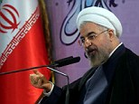 Contemplating cooperation: Iranian President Hassan Rouhani speaks during a press conference in the capital Tehran