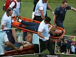 Carried off: Lewin is taken off on a stretcher with a dislocated ankle amid England's goal celebrations