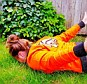 Persieing: A Holland fan donning her orange colours copies Robin van Persie's flying header