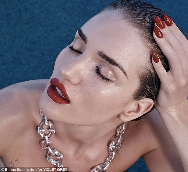 Vamping it up: Blood red lips and matching nail varnish helped Rosie achieve a vampish look