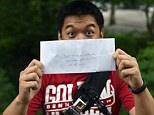 Winner!: Kurt Dee from Queens, New York, finds an envelope with money as part of the @HiddenCash scavenger hunt on June 14, 2014 in New York's Central Park