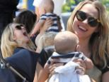 She's smitten! Doting mother Teresa Palmer lifts her baby boy Bodhi up in the air with delight as she enjoys a family day out