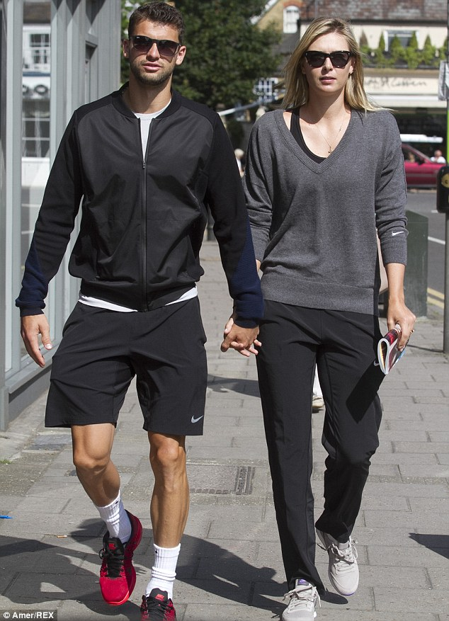 Time out: The tennis star looked relaxed during a break from Wimbledon training in a grey Nike sweatshirt