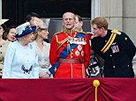 Prince Harry speaks with the Queen on the balcony of Buckingham Palace following the Trooping the Colour ceremony today