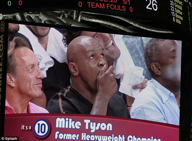 Caught on camera: Former heavyweight champion of the world Mike Tyson looked surprised to be put on the big screen