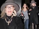 She's a fan! Diane Keaton walks arm-in-arm with daughter Dexter out of hockey game after the LA Kings win Stanley Cup