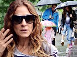 Rain and the city! Sarah Jessica Parker hikes up jeans as she strolls through rain with her daughters and Matthew Broderick