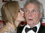 Pucker up! Daddy's girl Nicole Kidman plays the doting daughter as she gives her father Anthony a kiss on red carpet