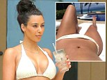 She's clearly eager to share the physical evidence of her wedded bliss. Kim Kardashian uploaded not one but two bikini body selfies on Thursday as she reclined outside a private villa in Punta Mita, Mexico, sunning her washboard tummy.