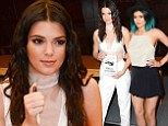 Risque: Kendall Jenner teamed a shiny white bra top with a pair of high-waisted dress pants at a book signing in Los Angeles on Thursday with her sister Kylie