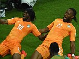 Kneesy does it: Ivory Coast's forward Gervinho celebrates with Didier Drogba after putting his side 2-1 up