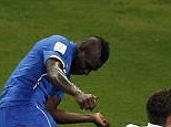Heads up: Italy striker Mario Balotelli (left) scores second goal against England