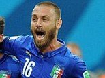 Joy: De Rossi (right) celebrates Italy's first goal but said afterwards that it was an honour to play against Gerrard