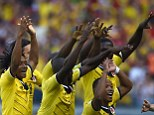 Together: Colombia celebrate together after Armero put them ahead in the sixth minute