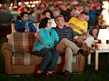 Sit back and relax: Supporters watch the World Cup sat on sofas positioned on the Union Berlin pitch