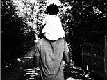 'Happy Happy Father's Day': Beyonce shares an adorable black and white snap of hubby Jay-Z carrying their daughter Blue Ivy on his shoulders