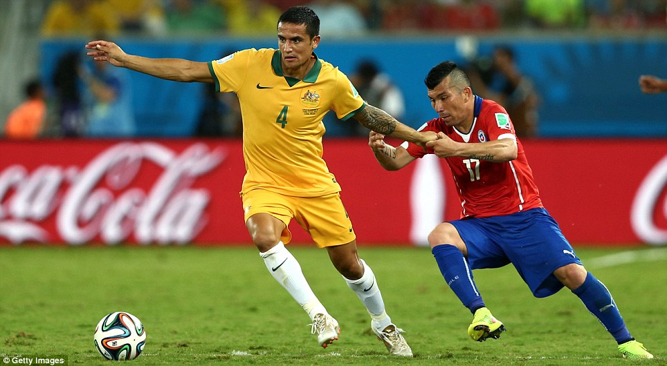 Cahill of Australia fought off a challenge by Chile's Gary Medel