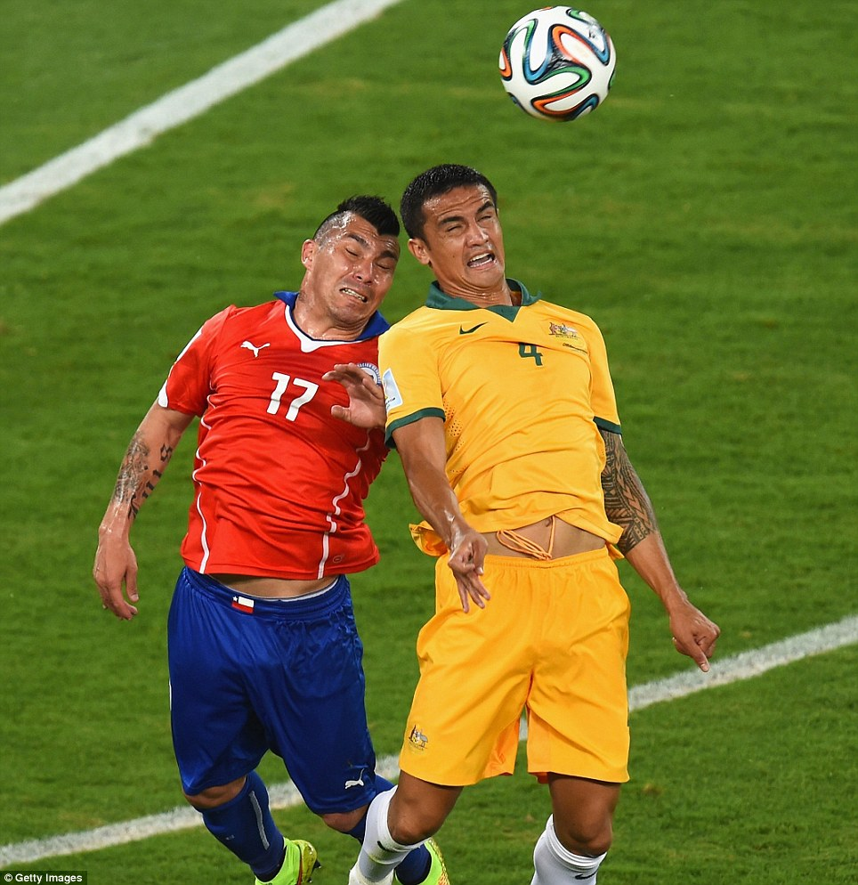 Medel and Cahill go up for a header