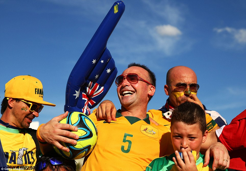 Support: Thousands of Australian fans travelled to Brazil to see Australia play their first game in their 2014 World Cup campaign