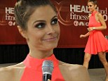 She's a tangerine dream! Maria Menounos is striking in a neon orange mini dress as she promotes new diet book