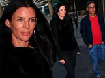 Liberty Ross displays long legs in skintight trousers as she attends LA Kings game with boyfriend Jimmy Iovine