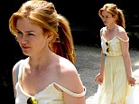 She's a ray of sunshine!  Isla Fisher looks cute in citrus as she hits the shops and does school run in lemon yellow dress