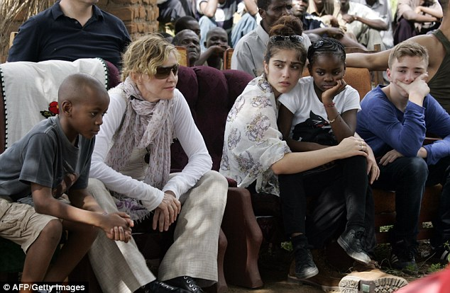 Nervous: The teenager, pictured with Madonna and her siblings during a trip to Malawi in April, has admitted to feeling the butterflies now that high school is finished