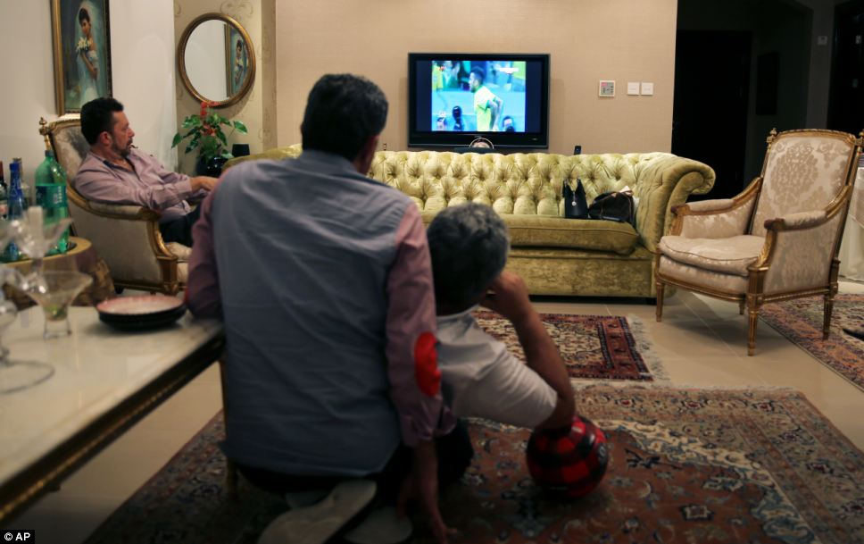 Middle East: Football fans in Dubai, United Arab Emirates settle down to watch the match