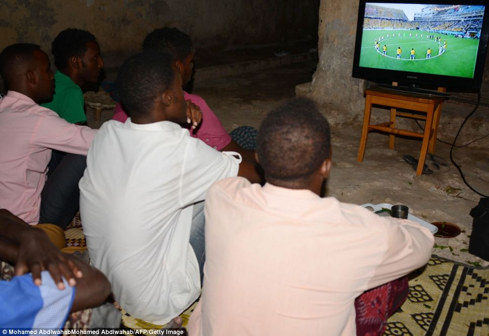 Fans  in the Somalian capital of Mogadishu watch the players as they ready themselves before the match