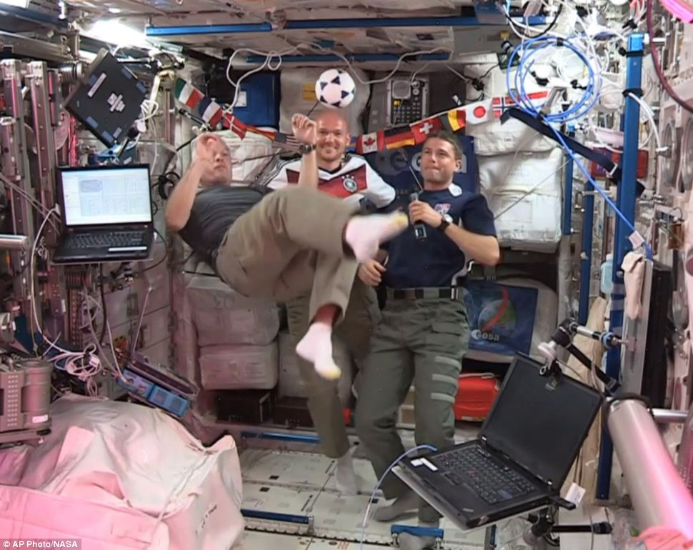 Out of this world: The sport may not be that popular in America but it seems Americans in outer space cannot get enough of football. United States astronauts Steve Swanson (left), Reid Wiseman (right), and German astronaut Alexander Gerst (centre), kick around a ball some 230 miles above Earth aboard the International Space Station