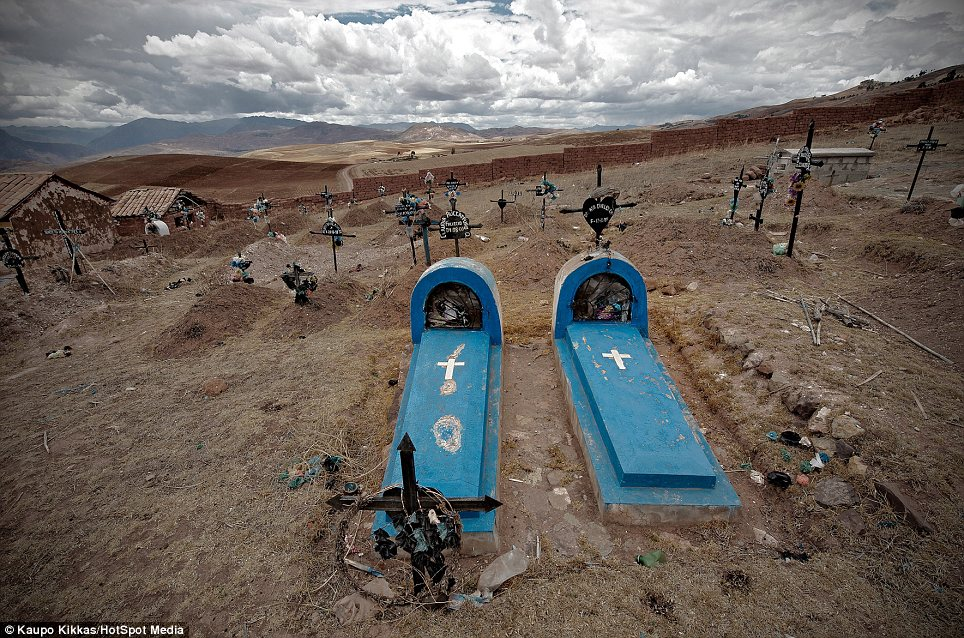 Quiet landscape: A graveyard in Maras, Peru. He says some of these settings 'could simply be a quiet landscape - not necessarily a final resting place'