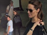 Angelina Jolie makes a stylish arrival at Heathrow airport with Brad Pitt in her first outing since becoming a Dame