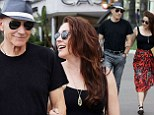 Smiling: Sir Patrick Stewart looks happy as he strolls with his wife in Cannes