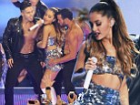 Ariana Grande hits the stage in revealing silver sequined crop top and mini skirt as she writhes around with male dancers at MuchMuch video awards