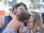 Smooches: The 37-year-old actress spent a low-key Father¿s Day with her husband, Christopher Jarecki, and their three-year-old son, Bear Blu, as they visited a local¿s Farmer¿s Market
