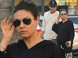 Easy Father's Day: Mila Kunis covered her bump in a tracksuit as she and her fiance Ashton Kutcher went grocery shopping at Ralph's in Sherman Oaks, California on Sunday