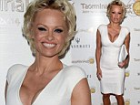 Ciao bella! Pamela Anderson shows off famed cleavage in plunging white dress while attending the Taormina Film Festival in Italy