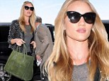 Stunning sight: Rosie Huntington-Whitely looked lovely in a trendy studded leather jacket as she arrived at Los Angeles International Airport on Sunday
