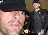 Coldplay touch down in Sydney for promo tour... but just what happened to Chris Martin's face?