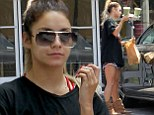 High and low maintenance: Vanessa Hudgens showed off her sculpted legs in a casual outfit as she picked up healthy green smoothies