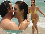 No need to practice privacy! 46-year-old Kate Walsh sizzles in yellow string bikini while cuddling up with boyfriend Chris Case in the ocean