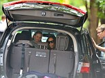 Road trip! Sarah Jessica Parker takes a seat alongside her daughter Marion while her husband Matthew Broderick looks on before a trip to the Hamptons