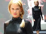Perky Nicole Kidman covers up her ample cleavage two days after wearing a VERY low cut gown that stole the show