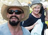Coordinating for the city: Hugh Jackman, right, and his wife Deborra-Lee Furness were both seen in hats as they arrived home in New York's West Village on Saturday