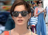 Anne Hathaway drowns her slim figure in bizarre billowing denim jumpsuit on casual day out in New York