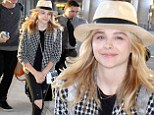 Chloe Moretz is a hip traveller donning a fedora and ripped jeans as she touches down in Toronto