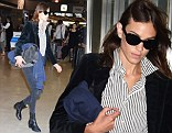 You can take the girl out of London: Alexa Chung arrives in Japan channeling Sloane style in striped shirt, velvet blazer and Chelsea boots