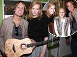 Hearts of gold! Keith Urban and Nicole Kidman donate signed guitar to Melbourne children's hospital during special star visit